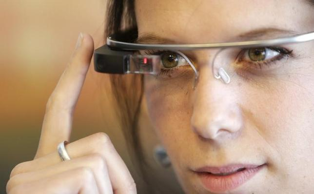 A woman wears Google glasses after a media presentation of a Google apartment in Prague May 15, 2014. REUTERS/David W Cerny