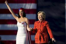 Democratic presidential candidate Hillary Clinton arrives with singer Katy Perry during a campaign rally in Des Moines, Iowa, October 24, 2015.  REUTERS/Scott Morgan/File photo