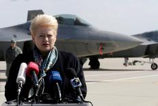 Lithuanian President Dalia Grybauskaite speaks to media in front of the U.S. Air Force F-22 Raptor fighters in the military air baser in Siauliai, Lithuania, April 27, 2016. REUTERS/Ints Kalnins - RTX2BVPK