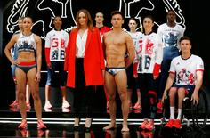 Olympics - Team GB Rio 2016 Olympic Games Kit Launch - Seymour Leisure Centre, London - 27/4/16 Team GB's Jessica Ennis-Hill, Tom Daley, Olivia Breen and teammates pose for a photo with designer Stella McCartney during the kit launch Reuters / Stefan Wermuth Livepic