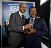 "Cast members Keegan-Michael Key (L) and Jordan Peele hold a kitten named Warren at the premiere of ""Keanu"" at ArcLight in Los Angeles, U.S., April 27, 2016.   REUTERS/Mario Anzuoni"