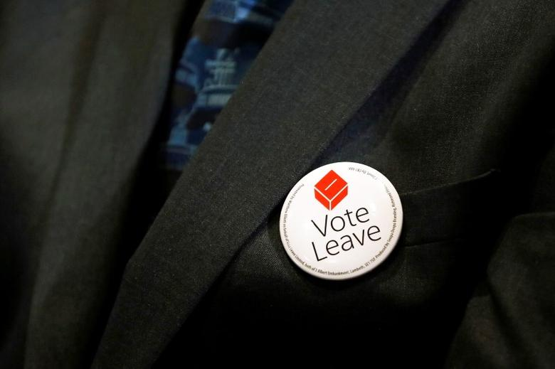 A man wears a Vote Leave badge during the launch of the EU referendum Women campaign for Britain, in London, Britain March 8, 2016. REUTERS/Stefan Wermuth