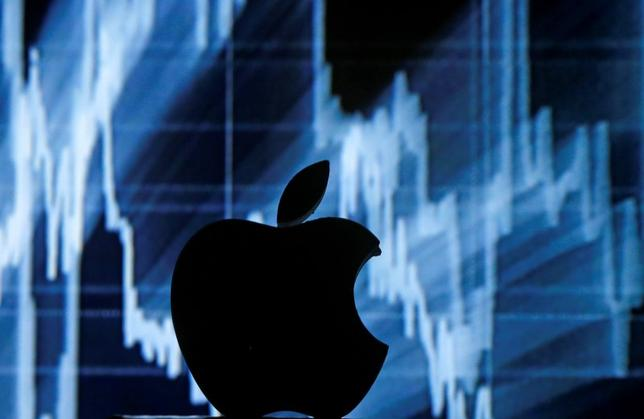 A 3D printed Apple  logo is seen in front of a displayed stock graph in this illustration taken April 28, 2016. REUTERS/Dado Ruvic/Illustration