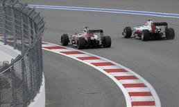 Formula One - Russian Grand Prix - Sochi, Russia - 30/4/16 - Toro Rosso F1 driver Carlos Sainz Jr of Spain and Haas F1 driver Romain Grosjean of France drive during the qualifying session. REUTERS/Maxim Shemetov