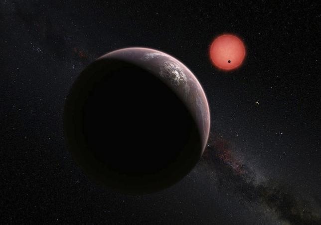 This artist's impression shows an imagined view of the three planets orbiting an ultracool dwarf star just 40 light-years from Earth that were discovered using a specialist telescope at ESO's La Silla Observatoryin Chile, according to new findings by an international team of astronomers, May 2, 2106. ESO/M. Kornmesser/N. Risinger/Handout via Reuters