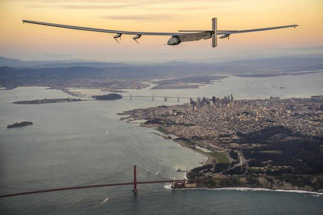 ''Solar Impulse 2'', a solar-powered plane piloted by Bertrand Piccard of Switzerland, flies over the Golden Gate bridge in San Francisco, California, U.S. April 23, 2016, before landing on Moffett Airfield following a 62-hour flight from Hawaii.  Jean Revillard/Solar Impulse/Handout via REUTERS