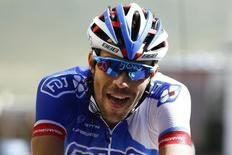 FDJ rider Thibaut Pinot of France reacts as he crosses the finish line to win the 110.5-km (68.6 miles) 20th stage of the 102nd Tour de France cycling race from Modane to Alpe d'Huez in the French Alps mountains, France, July 25, 2015. REUTERS/Stefano Rellandini