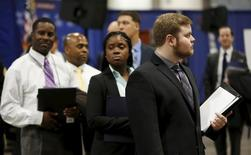 """Job applicants await their turn at the Lockheed Martin booth at a U.S. Chamber of Commerce Foundation """"Hiring Our Heroes"""" military job fair in Washington January 8, 2016.  REUTERS/Gary Cameron"""