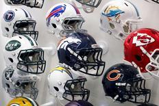 NFL team helmets are displayed at the NFL Headquarters in New York December 3, 2015. REUTERS/Brendan McDermid/Files