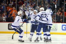 May 6, 2016; Brooklyn, NY, USA; Tampa Bay Lightning defenseman Jason Garrison (5) celebrates his game winning goal against the New York Islanders with teammates during the overtime period of game four of the second round of the 2016 Stanley Cup Playoffs at Barclays Center. Mandatory Credit: Brad Penner-USA TODAY Sports