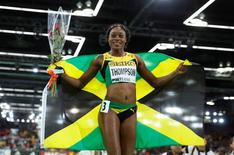 Elaine Thompson of Jamaica celebrates her bronze medal finish in the women's 60 meters final during the IAAF World Indoor Athletics Championships in Portland, Oregon March 19, 2016.   REUTERS/Lucy Nicholson
