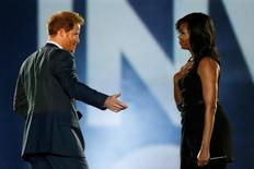 Britain's Prince Harry (L) and U.S. First Lady Michelle Obama take part in the opening ceremonies of the Invictus Games in Orlando, Florida, U.S., May 8, 2016.  REUTERS/Carlo Allegri