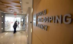 A woman walks into the head office for the World Anti-Doping Agency (WADA) in Montreal, November 9, 2015. REUTERS/Christinne Muschi