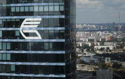 "The logo of VTB Group is seen through a window of Imperia Tower on the facade of the Federatsiya (Federation) Tower at the Moscow International Business Center also known as ""Moskva-City"", in Moscow, Russia, in this August 5, 2015 file photo.  REUTERS/Maxim Zmeyev/Files"