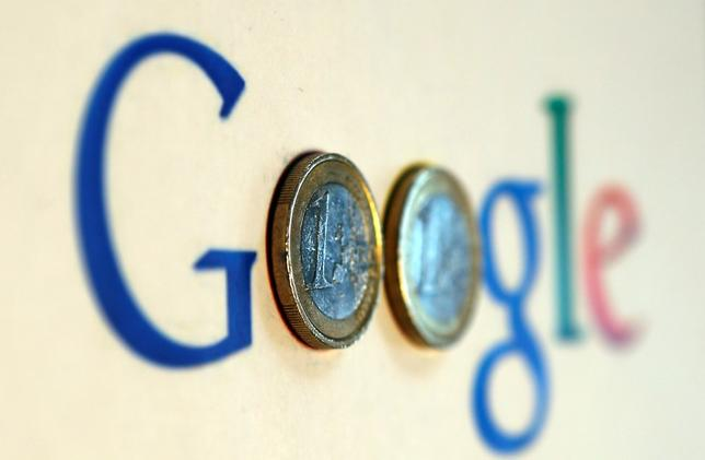 An illustration picture shows a Google logo with two one Euro coins, taken in Munich January 15, 2013.   REUTERS/Michael Dalder  (GERMANY - Tags: BUSINESS SCIENCE TECHNOLOGY)