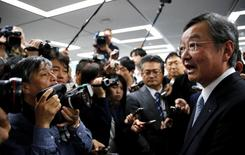 Sharp Corp Chief Executive Kozo Takahashi (R) speaks to the media after a company results news conference in Tokyo, Japan, May 12, 2016. REUTERS/Toru Hanai