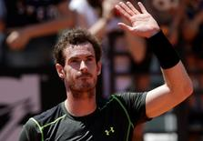 Andy Murray of Britain celebrates after beating Jeremy Chardy of France in their second round match at the Rome Open tennis tournament in Rome, Italy, May 13, 2015. Murray won the match 6-4 6-3.    REUTERS/Max Rossi