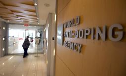 A woman walks into the head office for the World Anti-Doping Agency (WADA) in Montreal, Quebec, Canada on November 9, 2015.  REUTERS/Christinne Muschi/File Photo/Files