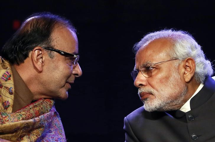 Prime Minister Narendra Modi (R) listens to Finance Minister Arun Jaitley during the Global Business Summit in New Delhi January 16, 2015. REUTERS/Anindito Mukherjee/Files