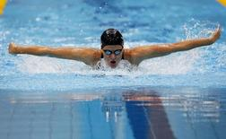 Kirsty Coventry of Zimbabwe swims in her women's 200m individual medley semi-final during the London 2012 Olympic Games at the Aquatics Centre July 30, 2012. REUTERS/David Gray