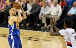 May 9, 2016; Portland, OR, USA; Golden State Warriors guard Stephen Curry (30) shoots for one of his 17 points in overtime against the Portland Trail Blazers in game four of the second round of the NBA Playoffs at Moda Center at the Rose Quarter. Mandatory Credit: Jaime Valdez-USA TODAY Sports
