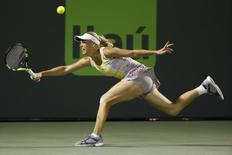 Mar 26, 2016; Key Biscayne, FL, USA; Caroline Wozniacki reaches for a forehand against Elina Svitolina (not pictured) during day five of the Miami Open at Crandon Park Tennis Center. Mandatory Credit: Geoff Burke-USA TODAY Sports