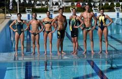 Members of the Australian Olympics swimming, diving and water polo teams pose for a photograph with their newly-unveiled Rio Olympic Games competition and training swimwear in Southport on Australia's Gold Coast, May 13, 2016.   AAP/Dan Peled/via REUTERS