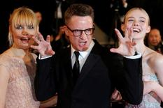 """Director Nicolas Winding Refn (C) and his wife Liv Corfixen (L) and cast member Elle Fanning arrive on the red carpet ahead of the screening for the film """"The Neon Demon"""" in competition at the 69th Cannes Film Festival in Cannes, France, May 20, 2016. REUTERS/Regis Duvignau"""