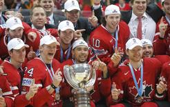 Ice Hockey - 2016 IIHF World Championship - Gold medal match - Finland v Canada - Moscow, Russia - 22/5/16 - Players of Canada pose with their gold medals and the trophy during the victory ceremony after the final game.     REUTERS/Maxim Shemetov