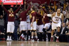 May 4, 2016; Cleveland, OH, USA; Cleveland Cavaliers guard Dahntay Jones (30) reacts after hitting a record breaking three-pointer during the fourth quarter against the Atlanta Hawks in game two of the second round of the NBA Playoffs at Quicken Loans Arena.  Mandatory Credit: Ken Blaze-USA TODAY Sports