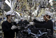 Employees work at the main assembly line of V6 engine at the Nissan Iwaki Plant in Iwaki city, Fukushima prefecture, Japan, April 5, 2016. REUTERS/Yuya Shino/File Photo