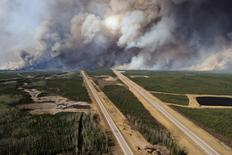 File photo of an aerial view of Highway 63 south of Fort McMurray, Alberta. Canada, showing smoke from the wildfires taken from a CH-146 Griffon helicopter May 5, 2016.  MCPL VanPutten/Canadian Armed Forces/Handout via Reuters