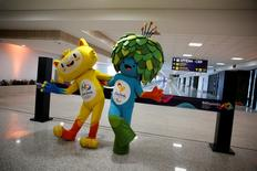 Olympic and Paralympic Games mascots Vinicius (L) and Tom pose during the opening ceremony of the new terminal at the international airport Galeao, which is expected to receive 1.5 million passengers during the 2016 Rio Olympics, in Rio de Janeiro, Brazil, May 19, 2016. REUTERS/Pilar Olivares