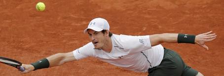 Tennis - French Open - Roland Garros - Ivo Karlovic of Croatia v Andy Murray of Britain - Paris, France - 27/05/16. Murray returns a shot. REUTERS/Jacky Naegelen