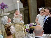 Archbishop Antje Jackelen holds Prince Oscar, during his christening, while Princess Estelle and Prince Daniel look on at the Royal Palace Chapel in Stockholm, Sweden May 27, 2016.TT News Agency/Jonas Ekstromer/via REUTERS