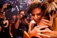 Talin Abu Hanah, an Israeli Arab, reacts after winning the first-ever Miss Trans Israel beauty pageant in Tel Aviv, Israel May 27, 2016. REUTERS/Amir Cohen