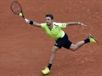 Tennis - French Open - Roland Garros - Viktor Troicki of Serbia v Stan Wawrinka of Switzerland - Paris, France - 29/05/16. Wawrinka returns a shot.  REUTERS/Jacky Naegelen