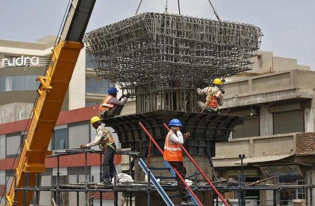 Labourers work at the site of metro railway flyover under construction in Ahmedabad, India, March 31, 2016. REUTERS/Amit Dave/Files