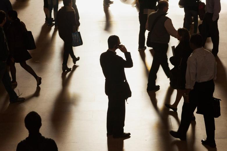 A man stands in the middle of Grand Central Terminal as he speaks on a cell phone, as passengers face limited train service on the New Haven Line between Stamford Station and Grand Central Terminal due to a Con Edison power problem in New York, September 25, 2013. REUTERS/Zoran Milich