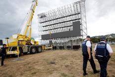 French police patrol as workers install a giant screen at a fan zone before the start of the UEFA 2016 European Championship in Marseille, France, June 1, 2016. REUTERS/Jean-Paul Pelissier