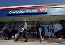 Pedestrians walk past a Couche-Tard convenience store in Montreal, April 18, 2012.   REUTERS/Christinne Muschi