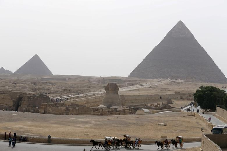 The Sphinx and the Great Pyramids of Giza are pictured on the outskirts of Cairo, Egypt, April 10, 2016.  REUTERS/Mohamed Abd El Ghany