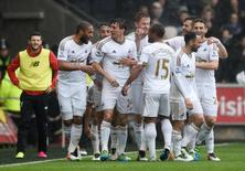 Britain Football Soccer - Swansea City v Liverpool - Barclays Premier League - Liberty Stadium - 1/5/16 Swansea's Jack Cork celebrates scoring their second goal with team mates Reuters / Rebecca Naden Livepic
