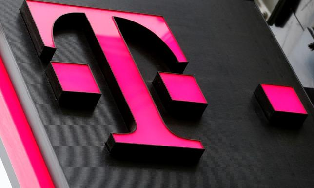 The logo of T-Mobile Austria is seen outside of one of its shops in Vienna, Austria, February 25, 2016.   REUTERS/Leonhard Foeger