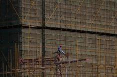 La Banque mondiale révise de 2,9% en janvier à 2,4% sa prévision de croissance mondiale, en raison notamment des bas prix des matières premières et du ralentissement de la demande dans les économies développées. /Photo prise le 14 avril 2016/REUTERS/Wong Campion