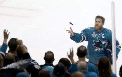 Jun 6, 2016; San Jose, CA, USA; San Jose Sharks center Joe Pavelski (8) throws a puck over the glass to fans before game four of the 2016 Stanley Cup Final where the San Jose Sharks play host to the Pittsburgh Penguins at SAP Center at San Jose. Mandatory Credit: John Hefti-USA TODAY Sports
