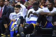 Jun 8, 2016; Cleveland, OH, USA; The Golden State Warriors players react from the bench during the final seconds in the fourth quarter of game three of the NBA Finals at Quicken Loans Arena. The Cavaliers won 120-90. Mandatory Credit: Ken Blaze-USA TODAY Sports