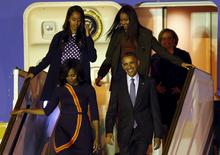 U.S. President Barack Obama and First Lady Michelle Obama arrive for their visit to Argentina with their daughters Malia (top, L) and Sasha and Michelle's mother Marian Robinson (back) at Buenos Aires' international airport, early March 23, 2016.  REUTERS/Marcos Brindicci