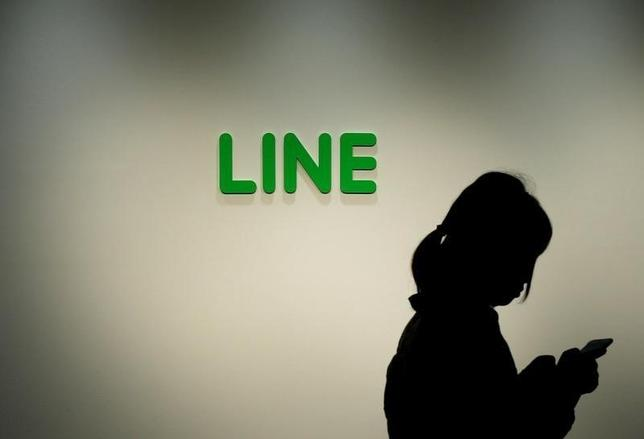 A woman walks past the logo of Line Corp at the company's headquarters in Tokyo, Japan June 2, 2016.  REUTERS/Toru Hanai/File Photo