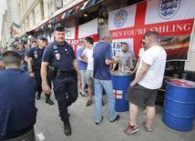 Police patrol near England fans ahead of their Euro 2016 soccer championship game  in Marseille, France, June 10, 2016.    REUTERS/Jean-Paul Pelissier
